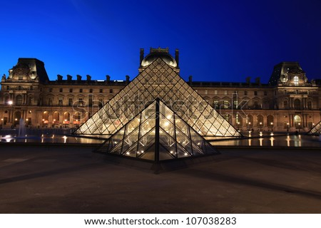 PARIS - MAY 13: View on the Louvre Pyramid and Pavillon Rishelieu in the evening, May 13, 2012, Paris, France. Louvre is the biggest museum in Paris with over 60,000 square meters of exhibition space.