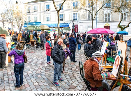 PARIS (MONTMARTRE),FRANCE - FEBRUARY 07, 2016: Place du Tertre in Montmartre, Paris with street artists and paintings