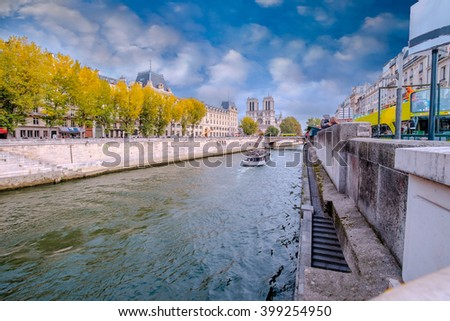 Paris - Notre Dame - Seine, France in a beautifull autumn day. Seine river in the foreground, cathedral in the background./Paris - Notre Dame - Seine, France - stock photo