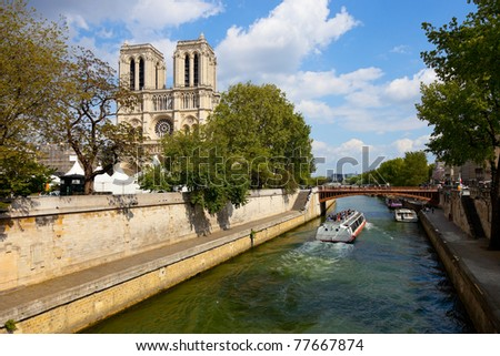 Paris, Notre Dame with boat on Seine, France. - stock photo