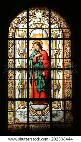 PARIS, NOV 07: Saint John the Evangelist, stained glass in church of St. Elizabeth situated in the 3rd arrondissement of Paris.