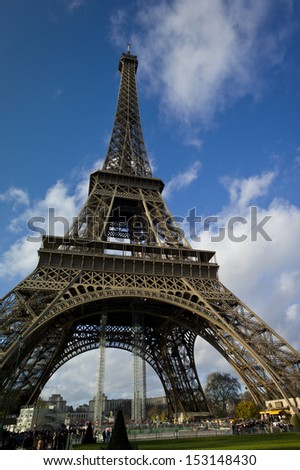 PARIS - NOV 30: The beautiful Eiffel Tower on November 30, 2012 in Paris, France. The Tower stands 324 metres (1,063 ft) tall. Monument was built in 1889, attendance is over 7 million people. - stock photo