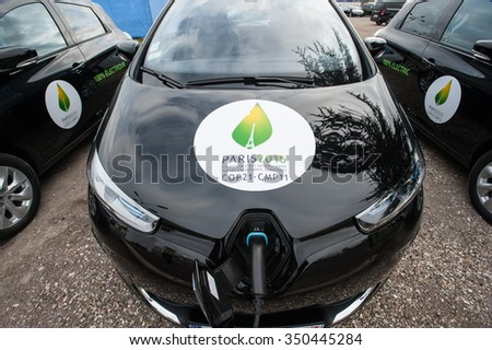 PARIS - NOVEMBER 30: A fleet of electric cars charges in front fo the COP21 UN climate conference in Le Bourget near Paris, France, November 30, 2015.