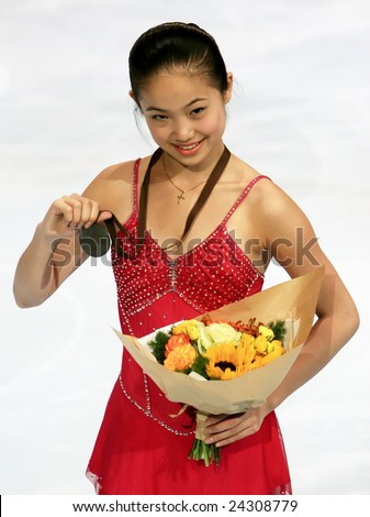 PARIS - NOVEMBER 15: American figure skater Caroline Zhang poses during medal ceremony at ISU Grand Prix - Eric Bompard Trophy in Bercy, Paris, France on November 15, 2008. - stock photo