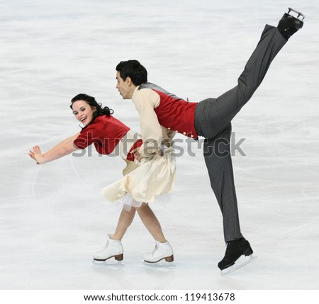 PARIS - NOVEMBER 16: Anna CAPPELLINI / Luca LANOTTE of Italy perform short dance at the ISU Grand Prix Eric Bompard Trophy on November 16, 2012 at Palais-Omnisports de Bercy, Paris, France. - stock photo