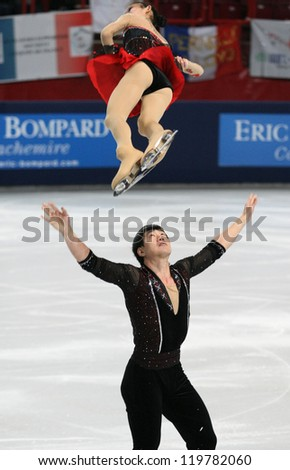 PARIS - NOVEMBER 16: Cheng PENG / Hao ZHANG of China perform during pairs short skating event at Eric Bompard Trophy on November 16, 2012 at Palais-Omnisports de Bercy, Paris, France. - stock photo