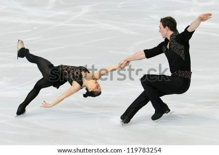 PARIS - NOVEMBER 16: Daria POPOVA / Bruno MASSOT of France perform during pairs short skating event at Eric Bompard Trophy on November 16, 2012 at Palais-Omnisports de Bercy, Paris, France. - stock photo