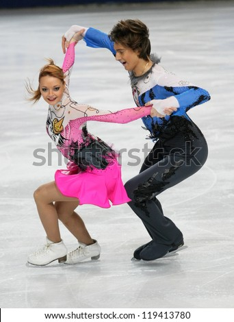 PARIS - NOVEMBER 16: Ekaterina PUSHKASH / Jonathan GUERREIRO of Russia perform short dance at the ISU Grand Prix Eric Bompard Trophy on November 16, 2012 at Palais-Omnisports de Bercy, Paris, France. - stock photo