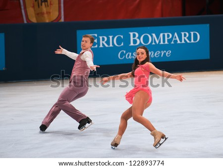 PARIS - NOVEMBER 16: Ekaterina RIAZANOVA / Ilia TKACHENKO of Russia perform at ice dance short dance event at Eric Bompard Trophy on November 16, 2012 at Palais-Omnisports de Bercy, Paris, France. - stock photo
