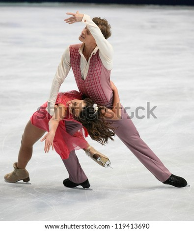 PARIS - NOVEMBER 16: Ekaterina RIAZANOVA / Ilia TKACHENKO of Russia perform short dance at the ISU Grand Prix Eric Bompard Trophy on November 16, 2012 at Palais-Omnisports de Bercy, Paris, France. - stock photo