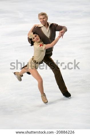 PARIS - NOVEMBER 14: France's ice dancers Isabelle Delobel / Olivier Schoenfelder perform original dance at Eric Bompard Trophy November 14, 2008 at Palais-Omnisports de Bercy, Paris, France. - stock photo