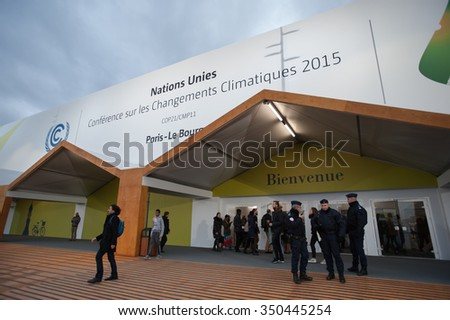 PARIS - NOVEMBER 29: French police stand guard as delegates approach the main hall of the COP21 United Nations climate summit in Paris, France, November 29, 2015. - stock photo