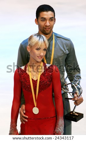 PARIS - NOVEMBER 15: German ice skaters Aliona Savchenko / Robin Szolkowy pose during medal ceremony at ISU Grand Prix - Eric Bompard Trophy in Bercy, Paris, France on November 15, 2008. - stock photo
