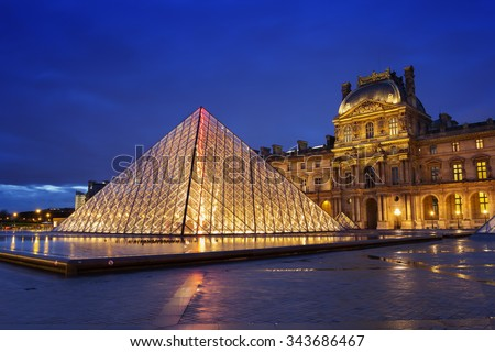 PARIS - NOVEMBER 20, 2015: Louvre museum at night. The Louvre is one of the largest museums in the world and one of the major tourist attractions of Paris.