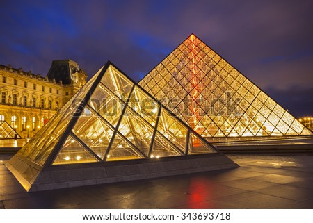 PARIS - NOVEMBER 20, 2015: Louvre museum at night. The Louvre is one of the largest museums in the world and one of the major tourist attractions of Paris. - stock photo