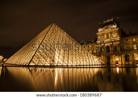 PARIS - NOVEMBER 09 : Louvre museum at twilight on November 09, 2013. Louvre museum is one of the world's largest museums with more than 8 million visitors each year.