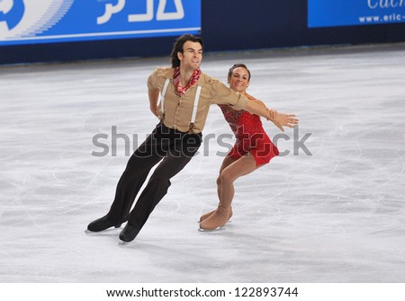 PARIS - NOVEMBER 16: Meagan DUHAMEL / Eric RADFORD of Canada perform at pairs short program event at Eric Bompard Trophy on November 16, 2012 at Palais-Omnisports de Bercy, Paris, France. - stock photo