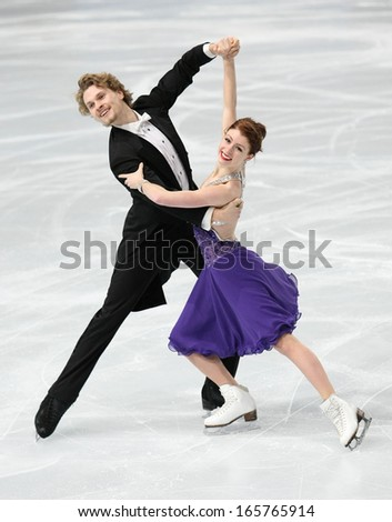 PARIS - NOVEMBER 15, 2013: Nicole ORFORD / Thomas WILLIAMS of Canada perform short dance at Eric Bompard Trophy 2013 in Palais-Omnisports de Bercy, Paris, France. - stock photo