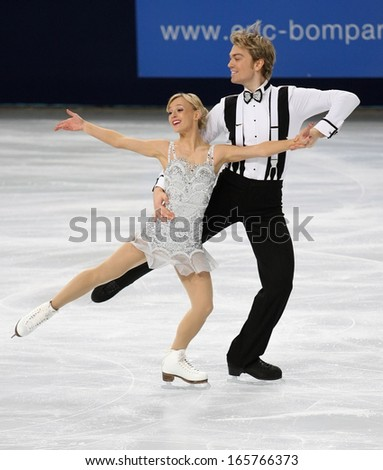 PARIS - NOVEMBER 15, 2013: Penny COOMES / Nicholas BUCKLAND of Great Britain perform short dance at Eric Bompard Trophy 2013 in Palais-Omnisports de Bercy, Paris, France.