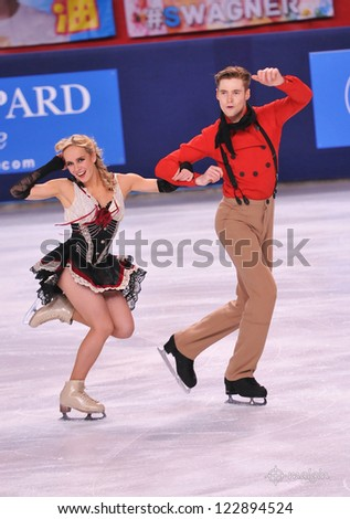 PARIS - NOVEMBER 16: Pernelle CARRON / Lloyd JONES of France perform at ice dance short dance event at Eric Bompard Trophy on November 16, 2012 at Palais-Omnisports de Bercy, Paris, France. - stock photo
