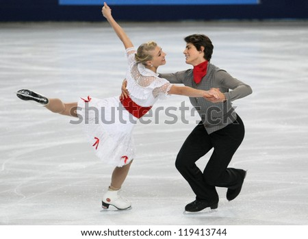 PARIS - NOVEMBER 16: Piper GILLES / Paul POIRIER of Canada perform short dance at the ISU Grand Prix Eric Bompard Trophy on November 16, 2012 at Palais-Omnisports de Bercy, Paris, France. - stock photo