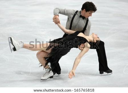 PARIS - NOVEMBER 15, 2013: Tessa VIRTUE / Scott MOIR of Canada perform short dance at Eric Bompard Trophy 2013 in Palais-Omnisports de Bercy, Paris, France. - stock photo
