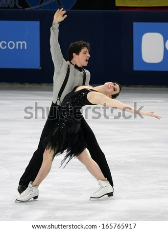 PARIS - NOVEMBER 15, 2013: Tessa VIRTUE / Scott MOIR of Canada perform short dance at Eric Bompard Trophy 2013 in Palais-Omnisports de Bercy, Paris, France.