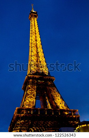 PARIS-NOVEMBER 5: The Eiffel tower on November 5, 2012  at night in Paris, France. Erected in 1889 as the entrance arch to the 1889 World's Fair, it has become a global cultural icon of France.