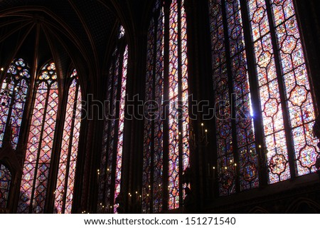 PARIS - NOVEMBER 06: The Sainte-Chapelle one of the most visited landmark in Paris, November 06, 2012. This 1246 inspired monument features 15 wonderful stain-glass windows in Paris.  - stock photo