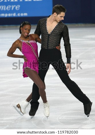 PARIS - NOVEMBER 16: Vanessa JAMES / Morgan CIPRES of France perform during pairs short skating event at Eric Bompard Trophy on November 16, 2012 at Palais-Omnisports de Bercy, Paris, France. - stock photo