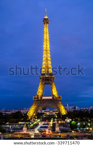 PARIS - OCT 18: Eiffel Tower Light Performance Show in Dusk 3 weeks before terror attack on October 18, 2015. The Eiffel tower is the most visited landmark in France.