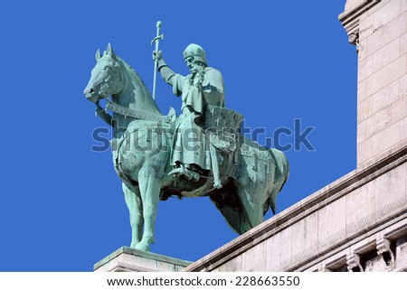 PARIS OCT 17: Equestrian Statue of Saint Joan of Arc on basilica Sacre Coeur on oct 17, 2014 in Paris, France. Joan of Arc (Maid of Orleans) is a folk heroine of France and Roman Catholic saint.