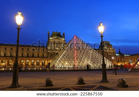 PARIS - OCT 17 : Louvre museum at twilight in summer on October 17, 2014. Louvre museum is one of the world's largest museums with more than 8 million visitors each year.  - stock photo