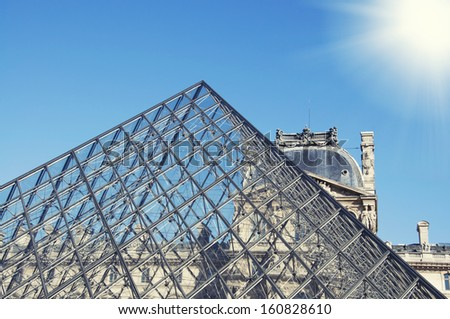 PARIS - OCT 10: Louvre pyramid on October 2010, Paris. Louvre is the biggest Museum in Paris displayed over 60,000 square meters of exhibition space. - stock photo