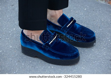 PARIS - OCTOBER 1: Blue velvet shoes before Chloe show, Paris Fashion Week Day 3, Spring / Summer 2016 street style on October 1, 2015 in Paris. - stock photo