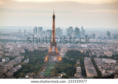 PARIS - OCTOBER 11: Paris cityscape with Eiffel tower on October 11, 2014 in Paris, France. It's an iron lattice tower located on the Champ de Mars and  was named after the engineer Gustave Eiffel.