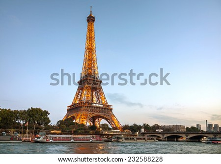 PARIS - OCTOBER 9: Paris cityscape with Eiffel tower on October 9, 2014 in Paris, France. It's an iron lattice tower located on the Champ de Mars and  was named after the engineer Gustave Eiffel. - stock photo