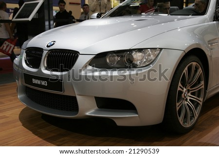 PARIS - OCTOBER 13 : People look at the Bmw m3 roadster at the 2008 Paris Motor Show October 13, 2008 in Paris. The show attracts more of one million people every 2 years - stock photo