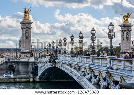 PARIS - OCTOBER 15: Pont Alexandre III (Alexandre III bridge) on October 15, 2012 in Paris.  The most ornate, extravagant bridge in Paris - stock photo
