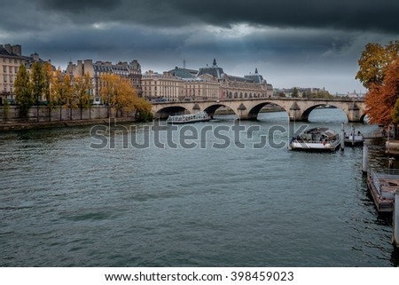 PARIS - October 25:Seine River in Paris, France in autumn.  Paris is one of the most visited cities in the world with about 28 million of visitors every year.