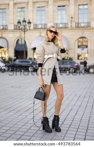PARIS - OCTOBER 5, 2016: Stylish European woman at Vendome Square during Paris Fashion week. With Fashion week in New York, London and Milan, they are the four biggest fashion events in the world.