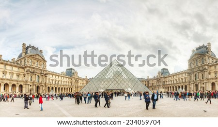 PARIS - OCTOBER 9: The Louvre with Pyramid on October 9, 2014 in Paris, France. It serves as the main entrance to the Louvre Museum. Completed in 1989 it has become a landmark of Paris. - stock photo