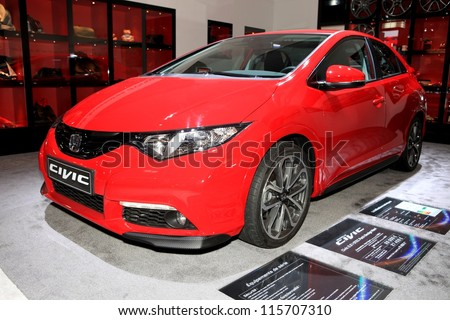 PARIS - OCTOBER 14: The new Honda Civic displayed at the 2012 Paris Motor Show on October 14, 2012 in Paris - stock photo