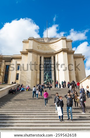 PARIS - OCTOBER 13, 2014: Unknown tourists on a large stair at trocadero square, in front of the Chaillot palace - stock photo