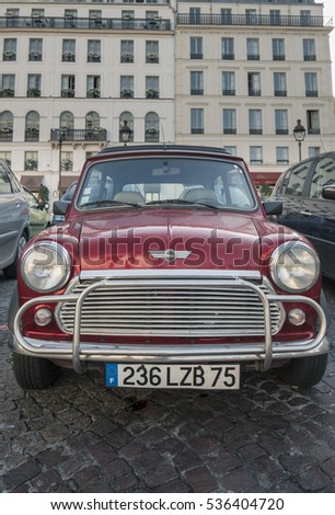 PARIS - OCTOBER 22: Vintage Mini Cooper parked in Paris on October 22, 2012 in Paris, France. Mini Cooper was an iconic car manufactured in United Kingdom in 1960s