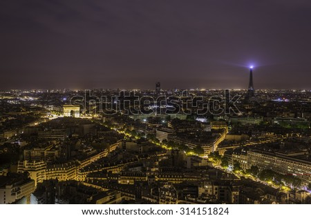 Paris panorama by night from high angle with Arch de Triomphe illuminated - stock photo