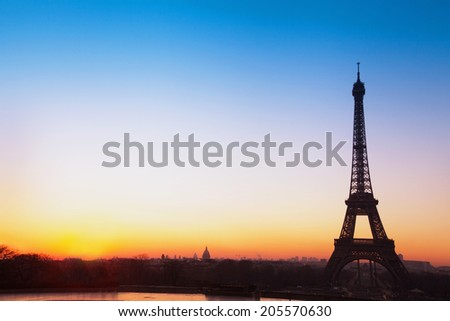 Paris panoramic view, silhouette of Eiffel tower at sunrise