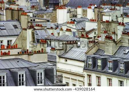 Paris roofs panoramic overview at summer day, France, traditional postcard picture