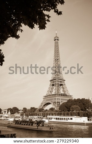 PARIS - SEP 09: Eiffel Tower at Paris downtown on September 09, 2014 in Paris, France. Paris, aka City of Love, is a popular travel destination and a major city in Europe - stock photo