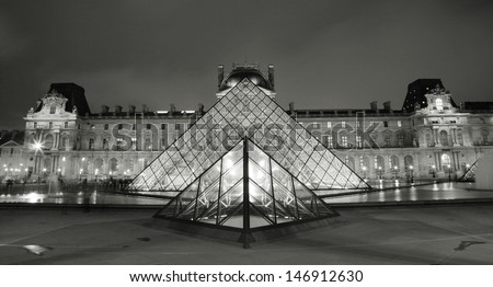 PARIS - SEP 24 : Night view of the Louvre, glass pyramid present, world's largest museums, most visited museum, more than 8 million visitors per year, opened from 1793 on Sep 24, 2010, Paris, France. - stock photo